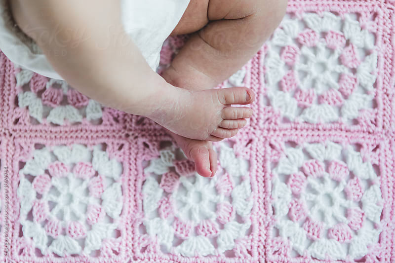 Small Feet of a Newborn Baby on a Blanket by Giorgio Magini for Stocksy United