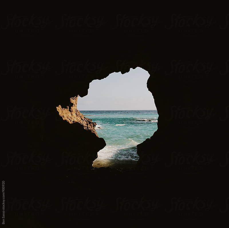 View of ocean through cave by Ben Sasso for Stocksy United