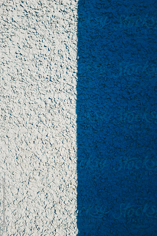 Shadow on exterior of building wall, painted blue by Paul Edmondson for Stocksy United