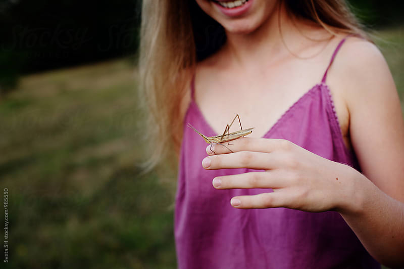 The girl and the grasshopper by Svetlana Shchemeleva for Stocksy United