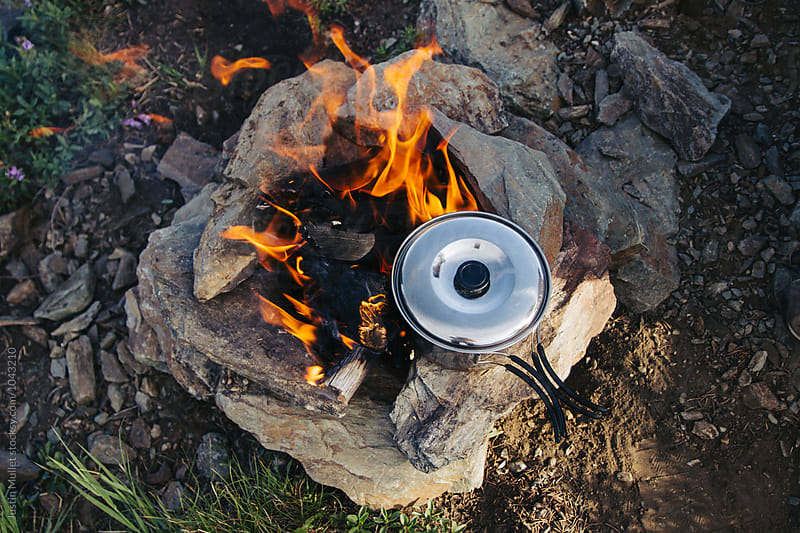 Cooking on a hiking trip by Justin Mullet for Stocksy United
