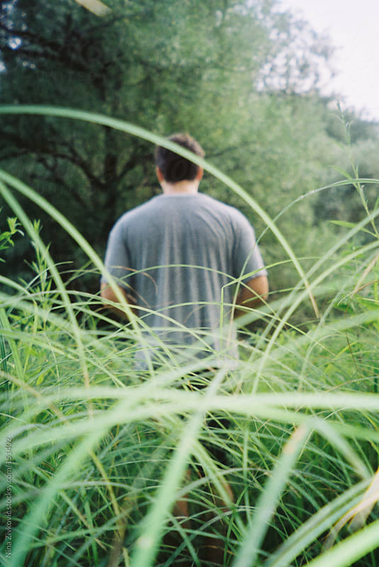 Deep in the grass.  by Nina Zivkovic for Stocksy United