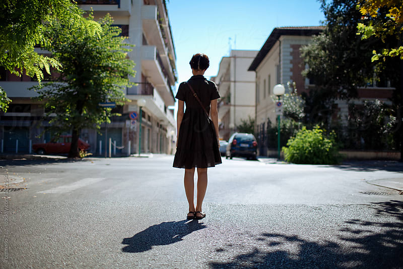 girl standing in the street by Tommaso Tuzj for Stocksy United