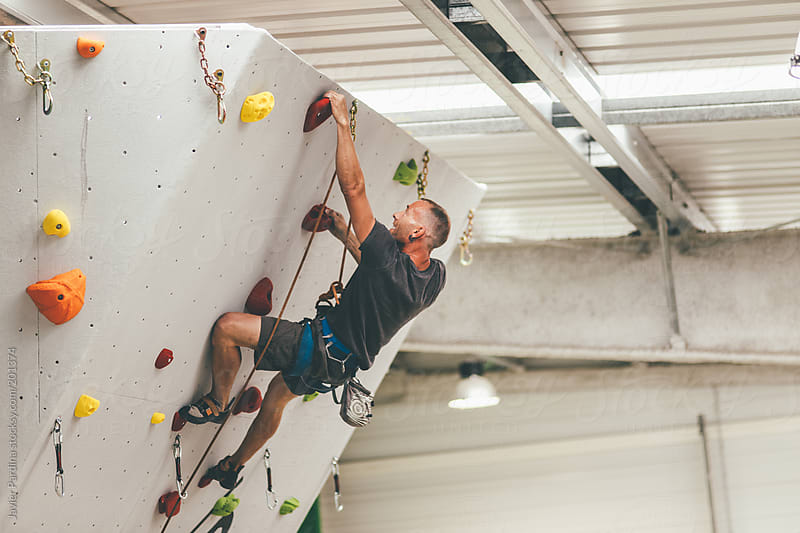 young people make Indoor climb sport  by Javier Pardina for Stocksy United