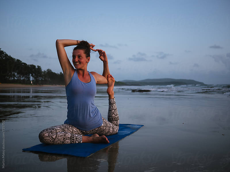 Yoga on the beach by Martin Matej for Stocksy United