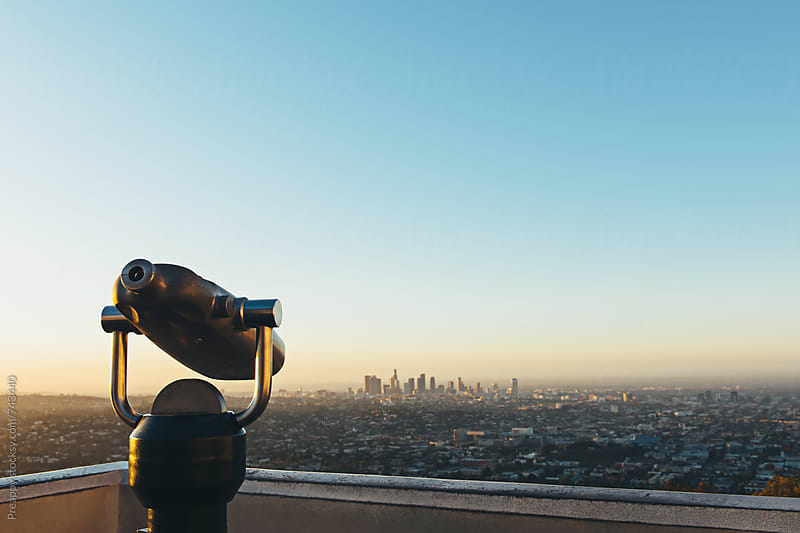 Tourist telescope overlooking Los Angeles by Preappy for Stocksy United