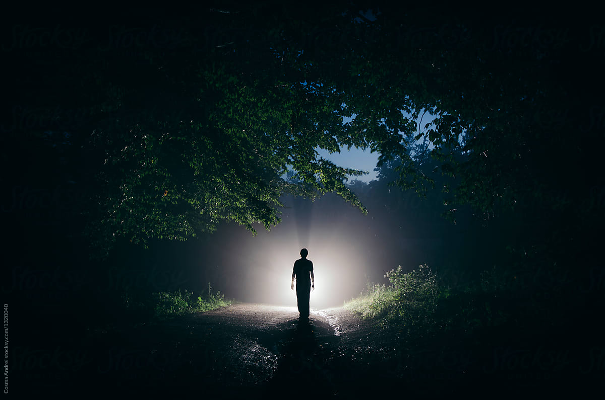 mysterious man in forest at night stocksy united