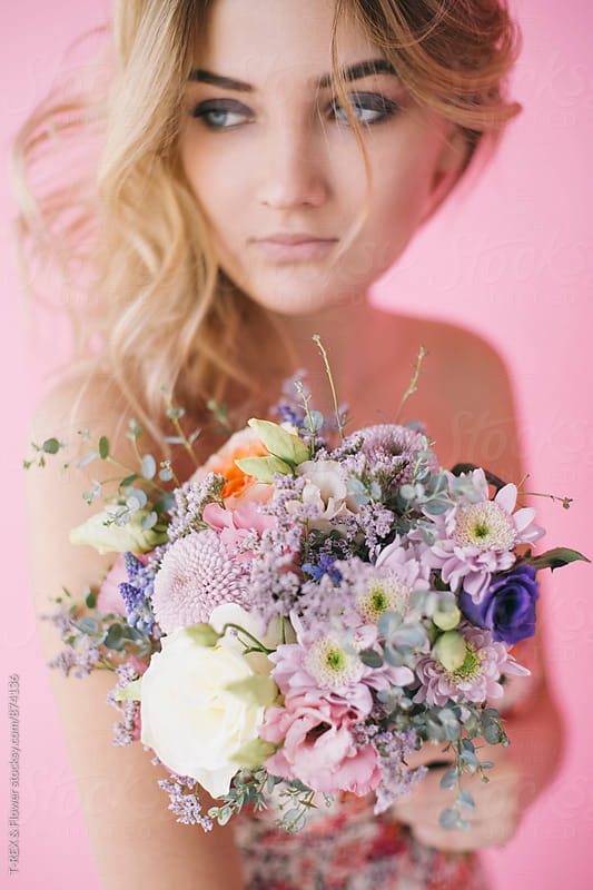 Attractive young woman holding beautiful bouquet  by T-REX & Flower for Stocksy United