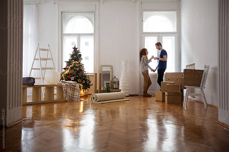 Young Couple Moving in at Christmas  by Lumina for Stocksy United
