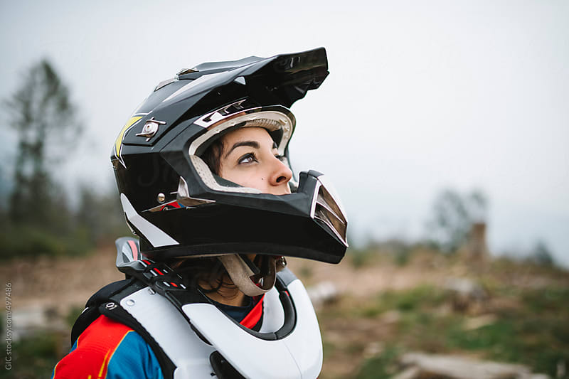 Young woman portrait with motocross helmet by GIC for Stocksy United