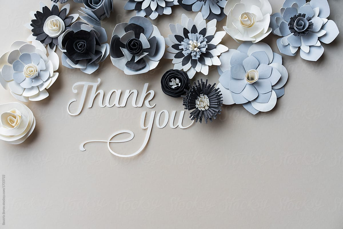 Word Thank You Cut Out Of Paper With Many Paper Flowers Stocksy United