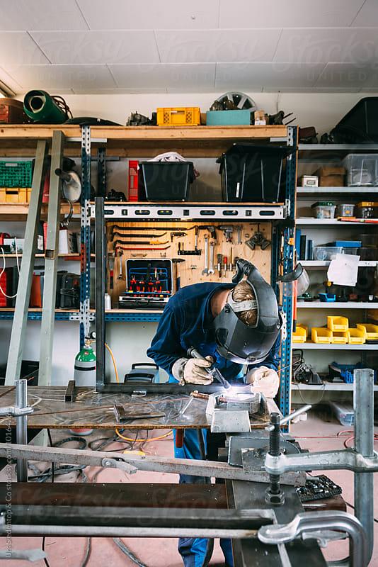Welding metal worker by Urs Siedentop & Co for Stocksy United