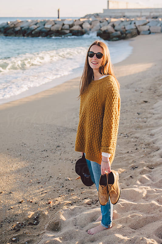Beautiful girl on the beach, in autumn by Vera Lair for Stocksy United