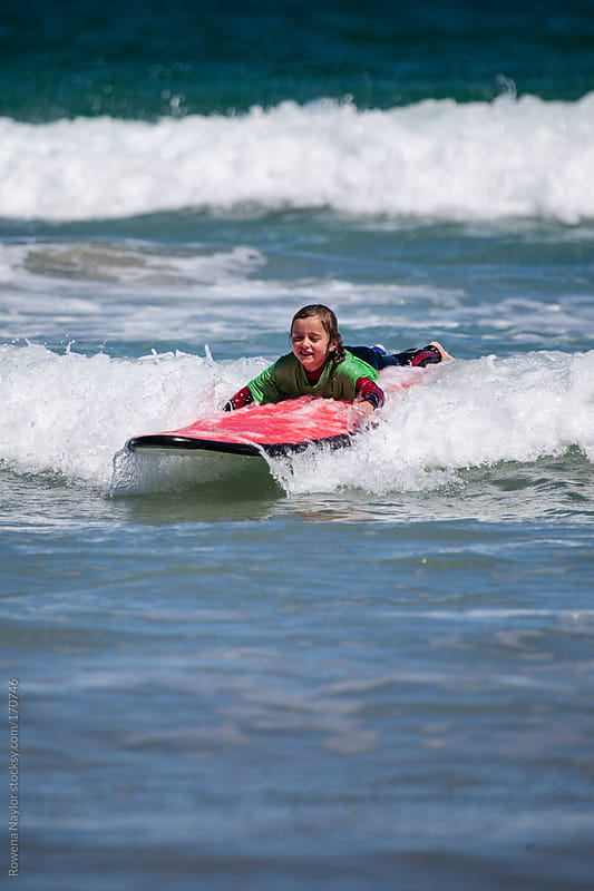 Young Girl Learning to Surf by Rowena Naylor for Stocksy United