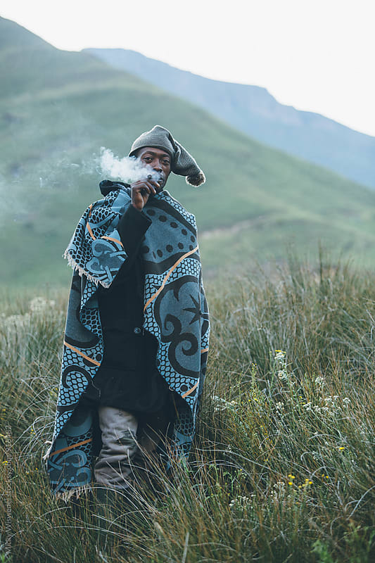 Portrait of a Basotho herdsman smoking by Micky Wiswedel for Stocksy United