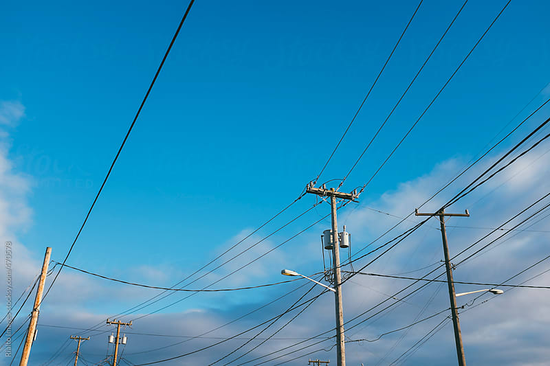 Electrical cables and telephone poles by Paul Edmondson for Stocksy United