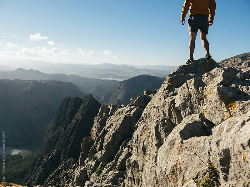 Hiker without head standing on the top of the el chorro rock by Martin Matej for Stocksy United