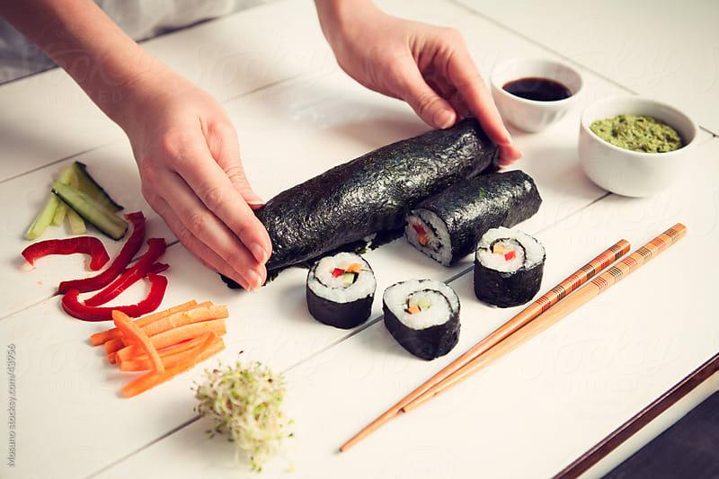 Preparing sushi. by Mosuno for Stocksy United
