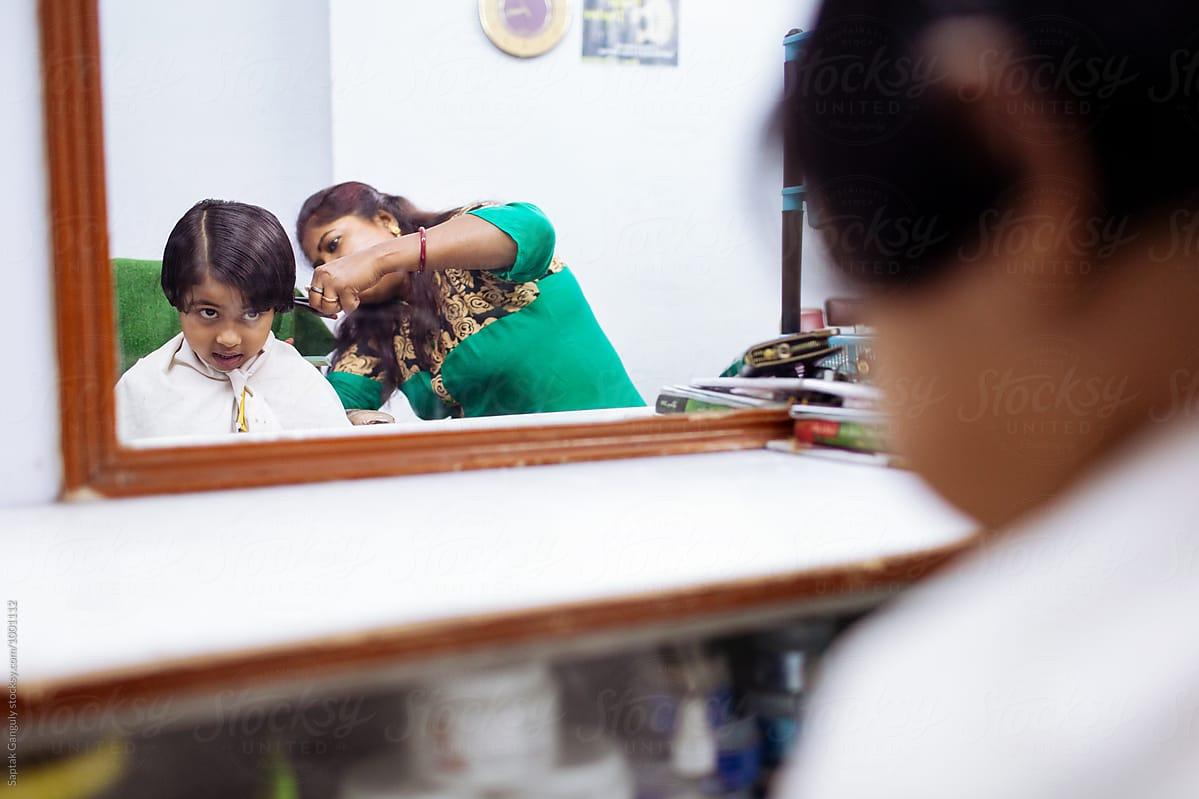 Little Girl Gets Hair Cut At Beauty Parlour Stocksy United