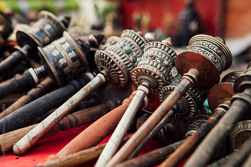 Prayer wheels on sale at a curio shop. by Shikhar Bhattarai for Stocksy United