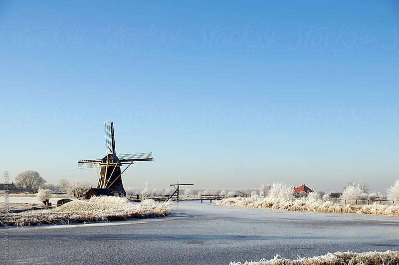 Winter landscape with mill by Harald Walker for Stocksy United