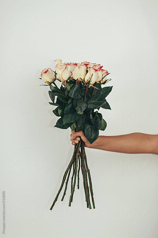 Hand holding bouquet of roses by Preappy for Stocksy United
