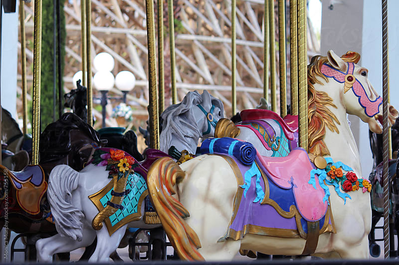 Colorful animals on the Merry Go Round by Monica Murphy for Stocksy United