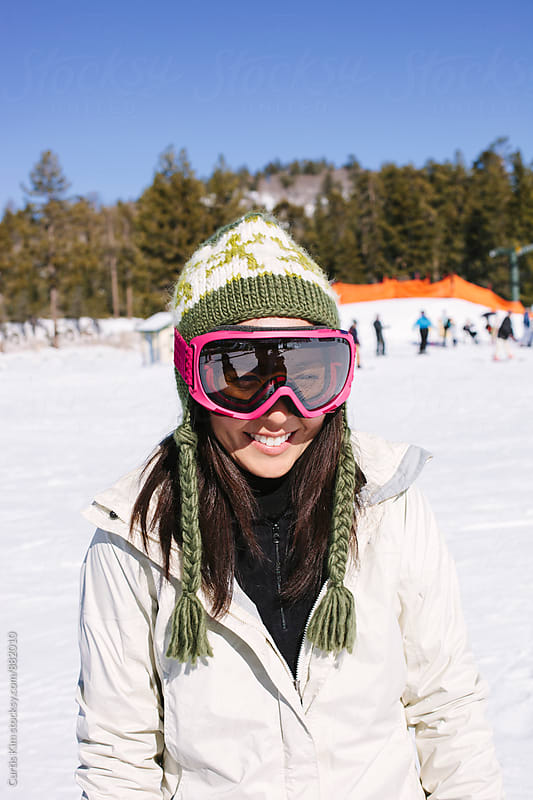 Portrait of a female snowboarder by Curtis Kim for Stocksy United