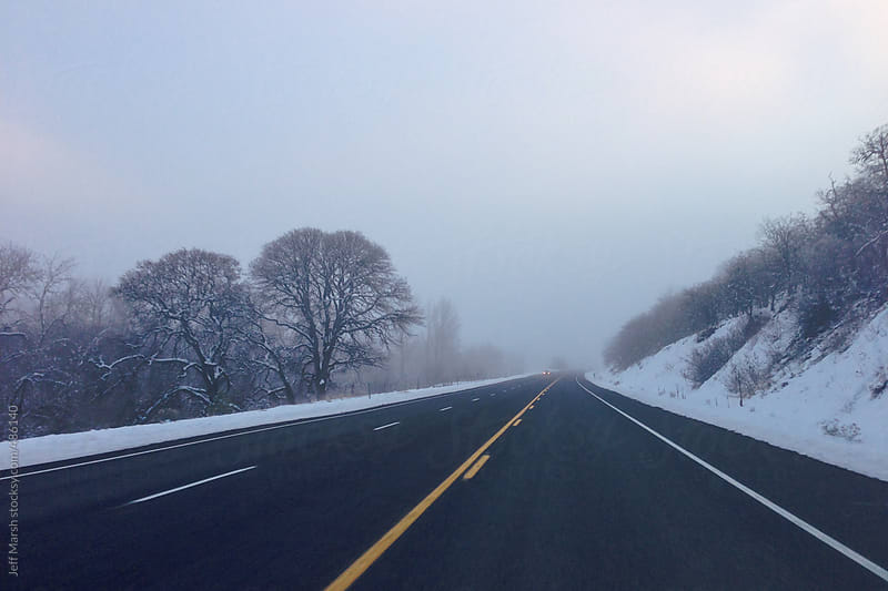 Road lined with Snow by Jeff Marsh for Stocksy United