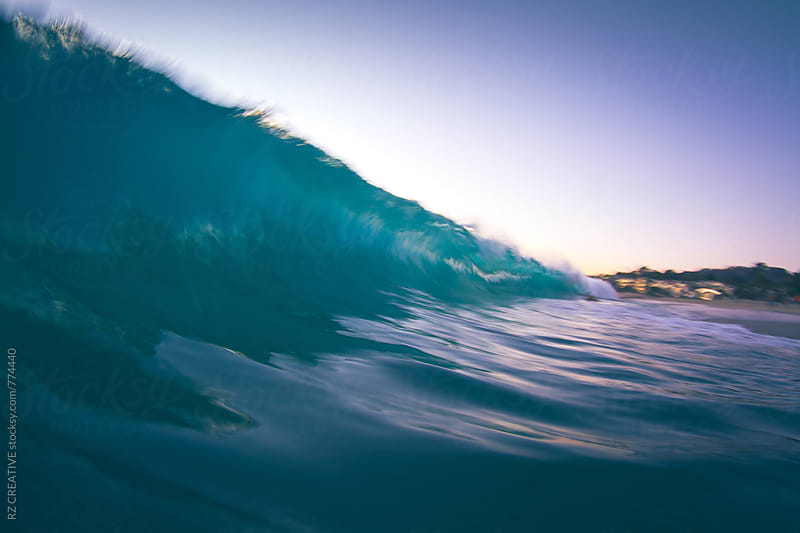 Slow shutter speed/water shot of a breaking wave at sunset. by Robert Zaleski for Stocksy United