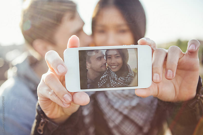 Couple Making a Selfie by Lumina for Stocksy United