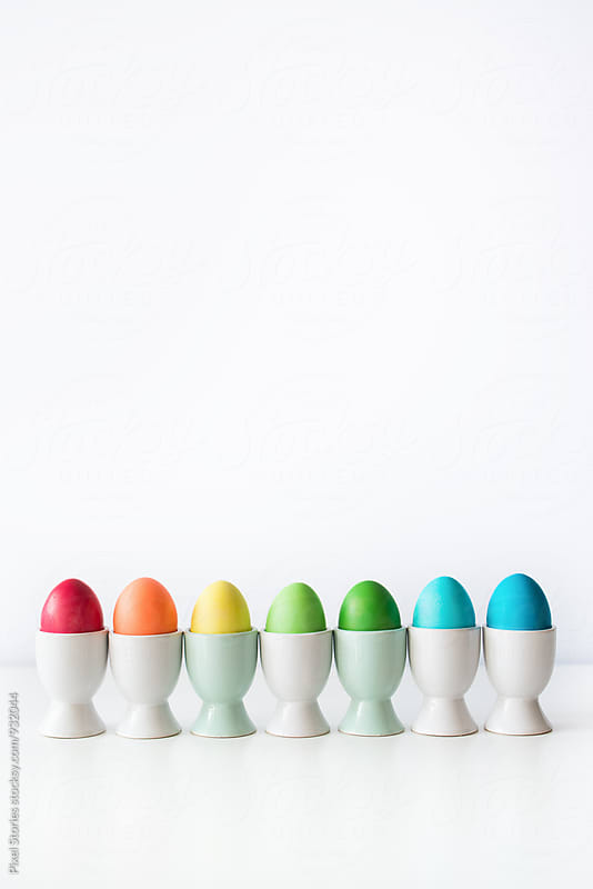 Colorful Easter eggs on white by Pixel Stories for Stocksy United