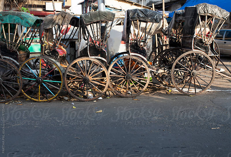 Hand Pulled rickshaw in the street of Kolkata,India by PARTHA PAL for Stocksy United