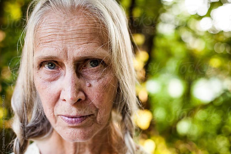 Elderly woman with blonde braids by J Danielle Wehunt for Stocksy United