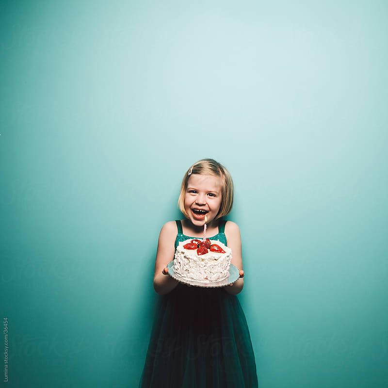 Girl Holding Birthday Cake by Lumina for Stocksy United