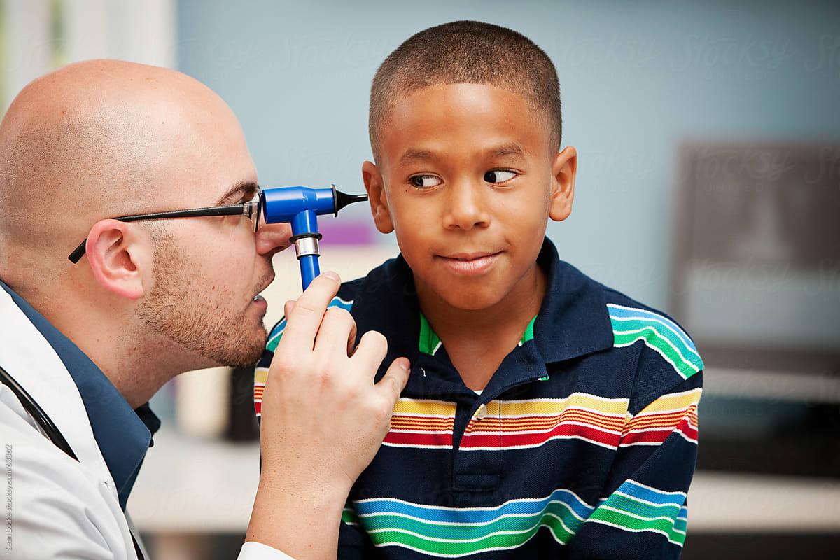 Pediatrician: Using an Otoscope to Check Ears by Sean Locke