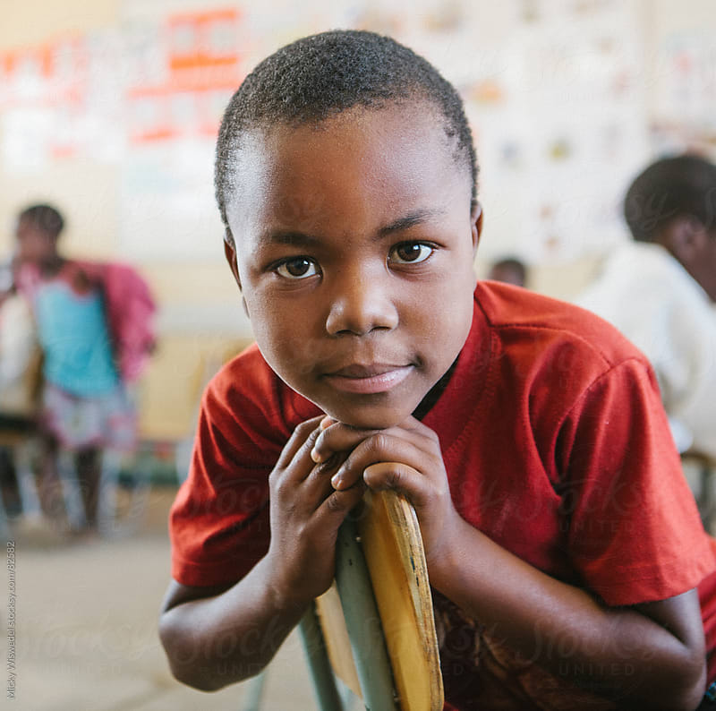 Young African school boy portrait by Micky Wiswedel for Stocksy United