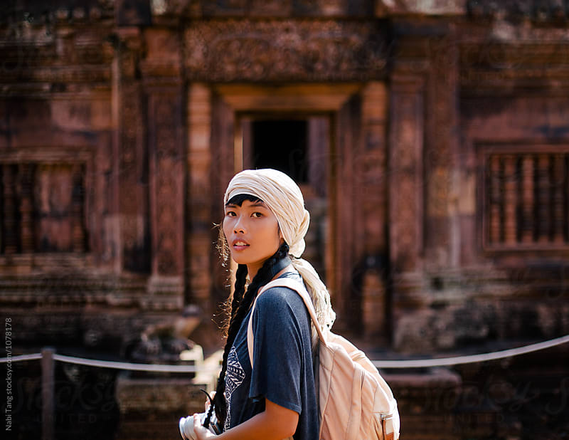 Female traveller at Banteay Srei temple in Siem Reap (Cambodia) by Nabi Tang for Stocksy United