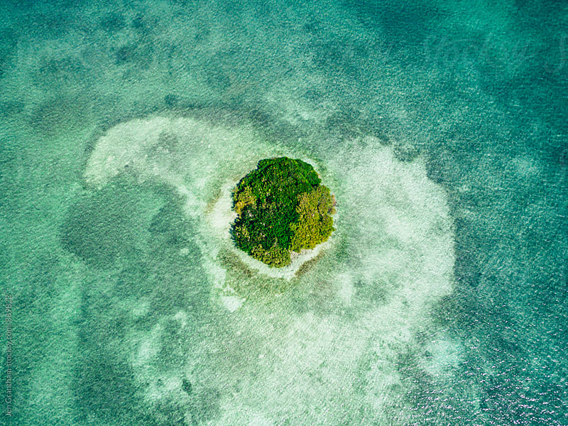 Overhead drone shot of a tiny island in the Atlantic Ocean by Jen Grantham for Stocksy United