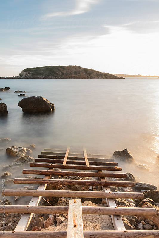 Wooden gangway into the sea by Marilar Irastorza for Stocksy United