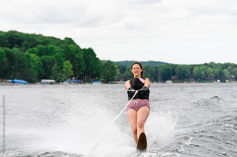 woman having fun water skiing by Margaret Vincent for Stocksy United
