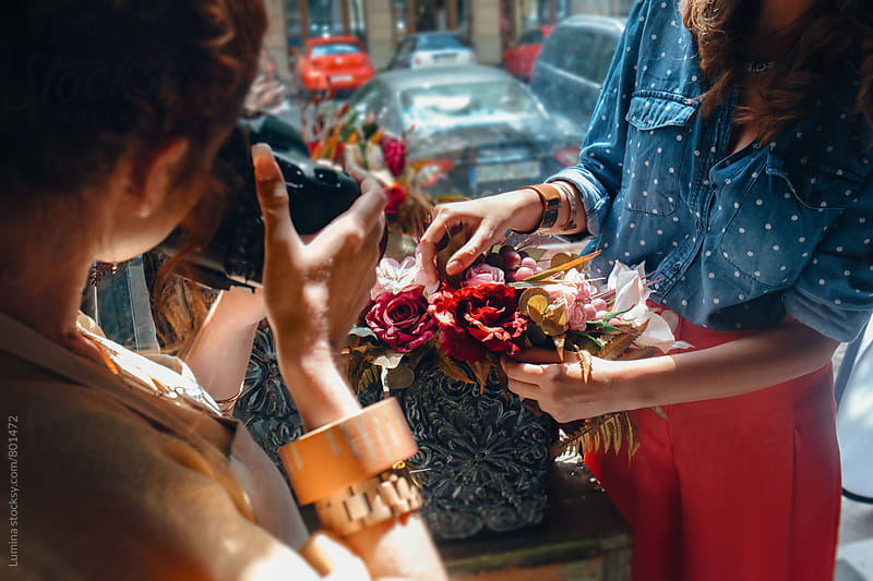 Florist Photographs Flower Arrangements in a Flower Shop by Lumina for Stocksy United
