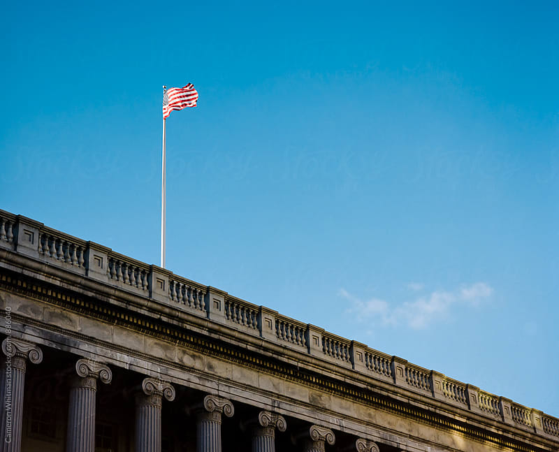 American Flag on Government Building in Washington DC by Cameron Whitman for Stocksy United