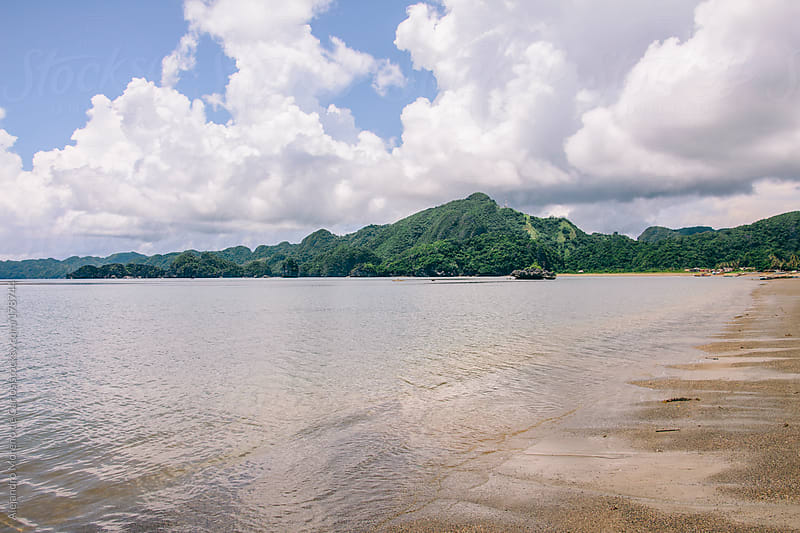Beach and rainforest in Caramoan Peninsula, Philippines by Alejandro Moreno de Carlos for Stocksy United