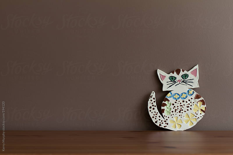Colorful hand-painted handmade ceramic cat by Kerry Murphy for Stocksy United