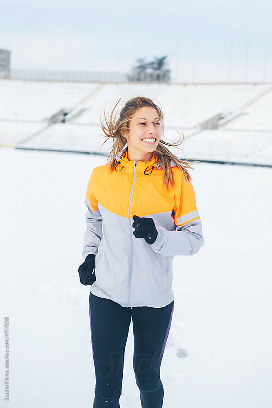 Woman Running on Snow Time. by Studio Firma for Stocksy United