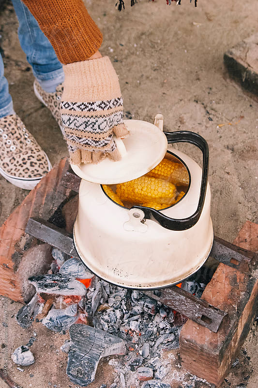 Boiling corn in kettle by Danil Nevsky for Stocksy United