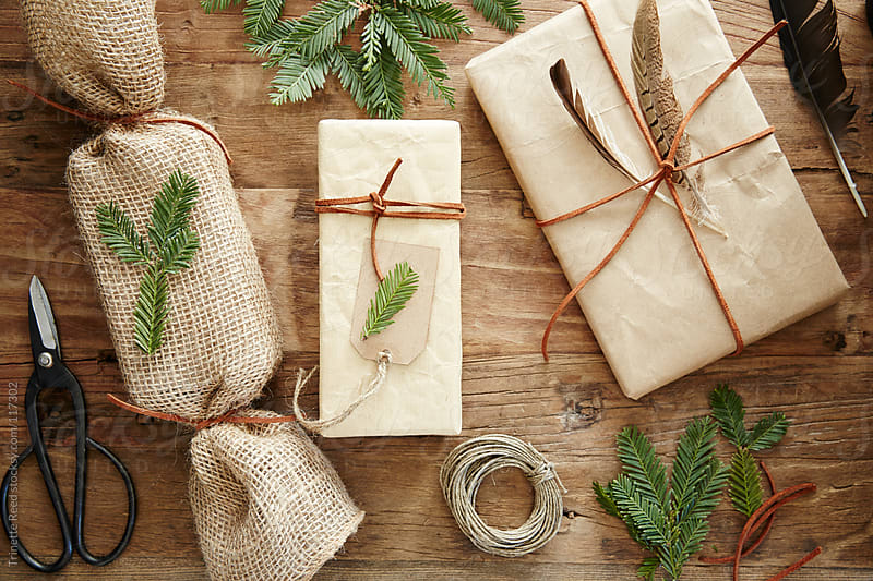 Still life of homemade wrapped christmas presents with nature elements by Trinette Reed for Stocksy United