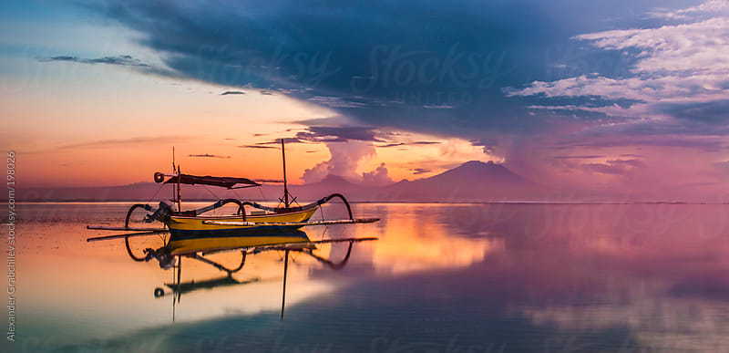 Seascape With Dawn Sky & Fisherman's Boat  by Alexander Grabchilev for Stocksy United