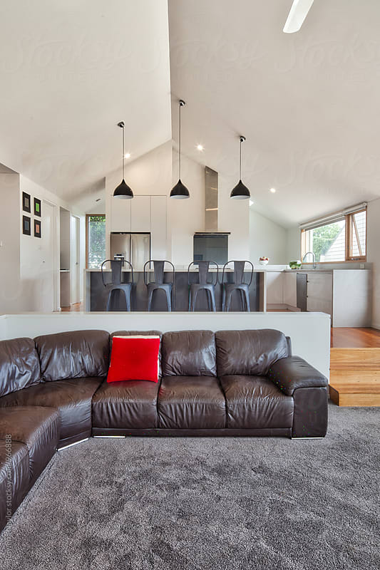 Interiro of modern home with sunken lounge by Rowena Naylor for Stocksy United